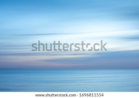 Intentional camera movement creating a dreamy, blurred effect of the sea at Brighton and Hove, East Sussex. Stock fotó ©