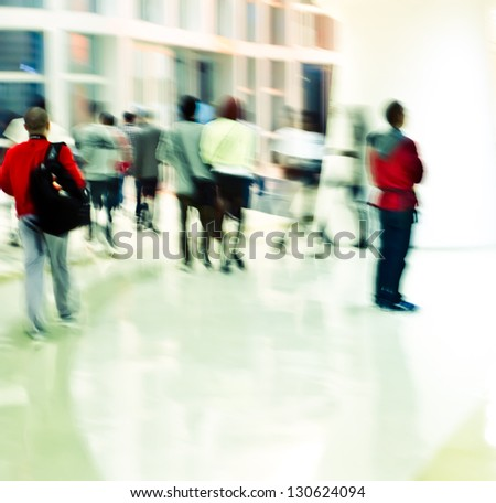 Intentional motion blur, city business people walking in the lobby