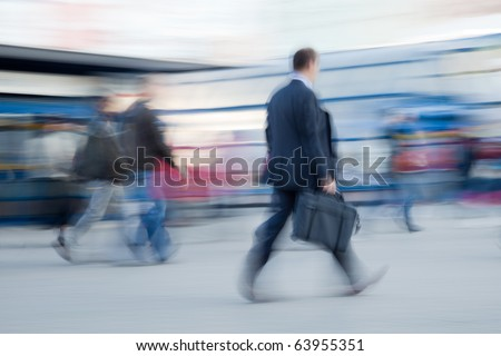 Intentional motion blurred image of businessman rushing to office in the morning
