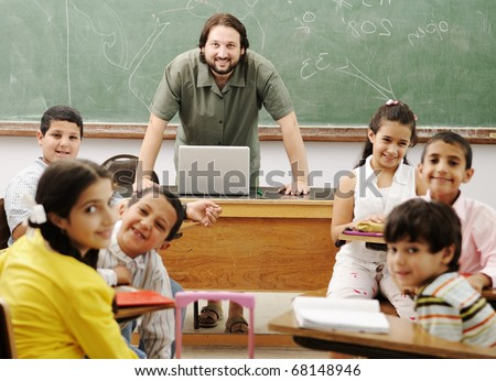 Interaction between male teacher and children, funny class in school