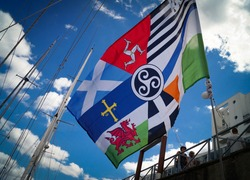 Interceltique flag, masts and blue sky in the port of Lorient, Brittany in France during the Interceltique festival of Celtic music and culture