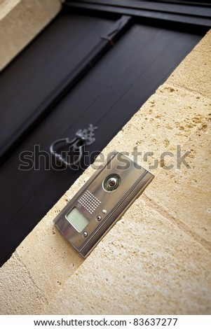 Intercom at the entrance of a stone house