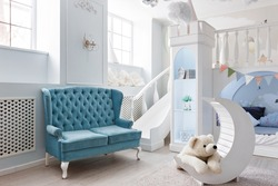 interer of a spacious blue children's room. decorative castle game