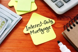 Interest Only Mortgage phrase on the paper home.