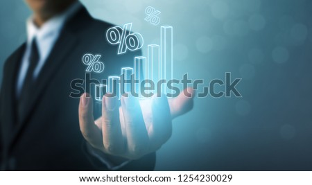 Interest rate financial and mortgage rates concept. Businessman hand show icon percent 3d sign with graph indicator
