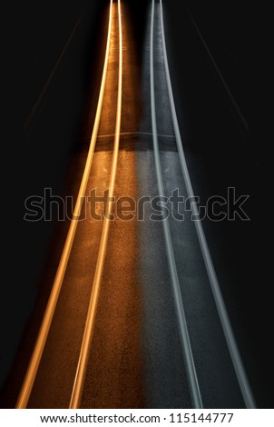 Interesting and abstract yellow and black and white lights that can be used as background or texture