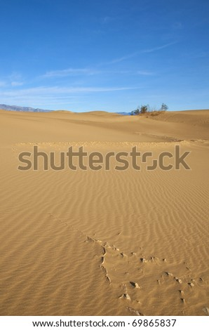 Interesting eroded rock formation in the Mesquite Sand Dunes of Death Valley, California.