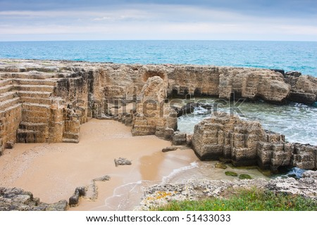 Interesting landscape of an ancient quarry by the sea at Torre Egnatia, close to Bari, in Italy.
