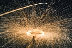 Interesting light effect that has been achieved through long exposure. The photo belongs to the category of steel wool photography.