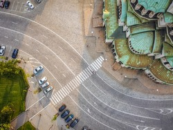 Interesting pedestrian crossing near Saint Alexander Nevski cathedral church in Sofia Bulgaria. Sofia city center from above, aerial photography. Domes of the cathedral with paved curvy street around