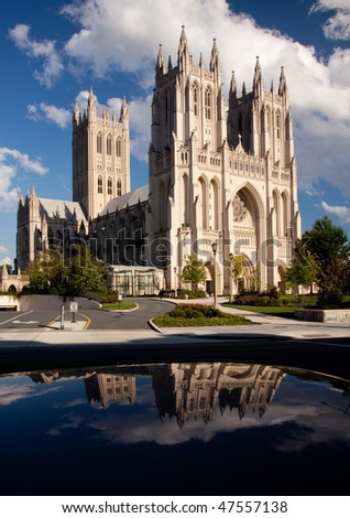 Interesting perspective of Washington National Cathedral reflected in roof of car parked opposite