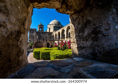 Interesting View Through a Window Through Thick Stone Walls of the Court Yard of the Historic Old West Spanish Mission San Jose, Founded in 1720, San Antonio, Texas,