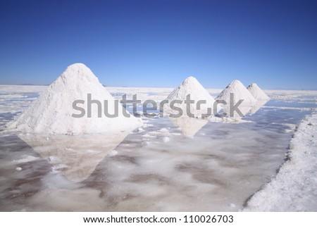 Interesting white salt pyramids in the world's largest salt desert, Salar Uyuni, Bolivia, near border with Chile, south America.