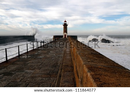 Interesting wide perspective from the pier at the mouth of the Douro River and its two beacons on a rough sea day