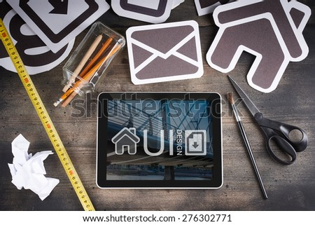 interface icons and equipment on wooden table