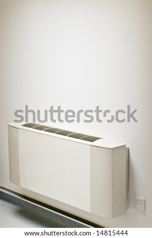 interior air-conditioner unit on white wall