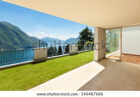 Interior apartment with garden, view from veranda