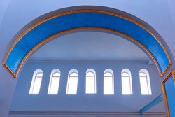 Interior architectural arch of the church . Religious symbols . Arched windows with natural light illumination
