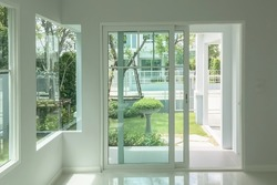 Interior atmosphere minimal style design of empty room show white wall with sliding door and glass windows looking through the outdoor garden.