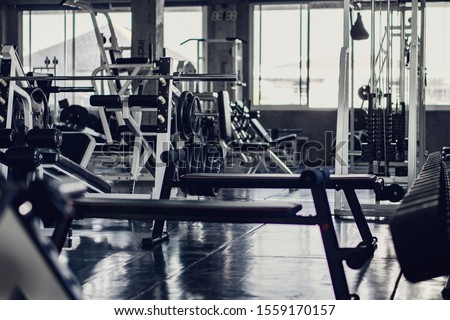 interior background of room in gym or fitness center fully equip of bodybuilding equipments and machines #1559170157