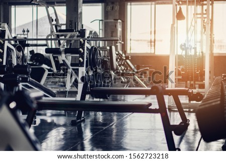 interior background of room in gym or fitness center fully equip of bodybuilding equipments and machines #1562723218