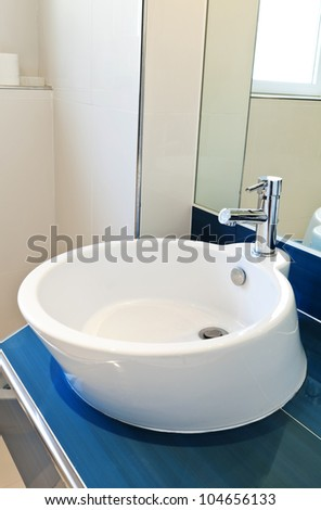 interior bathroom in modern house, sink and mirror