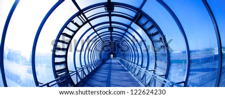 Interior blue glass tunnel, city public construction
