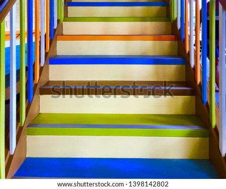 Interior brightly colored wooden stairs #1398142802