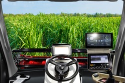 Interior cabin of smart agricultural machine and harvesting in sugar cane plantation
