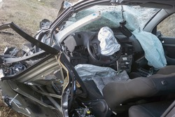 Interior car after terrifying deadly crash accident after a frontal collision. Twisted metal and destruction after a violent head-on collision between two cars on the road.