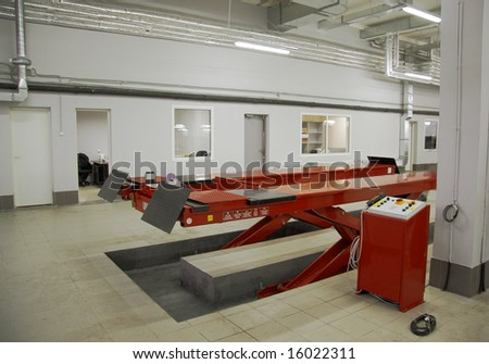 interior car-care center. The electric lift for cars in the service center