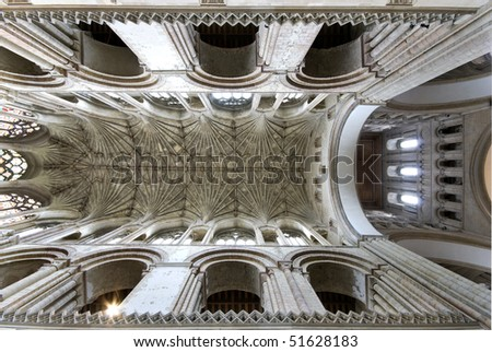 Interior ceiling  of the nave of Norwich Cathedral showing arches and bosses.