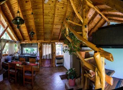 Interior comfortable eco friendlywooden house with all comforts for a holiday in the mountain forest. Near town  Bariloche, Argentina in Patagonia in South America.