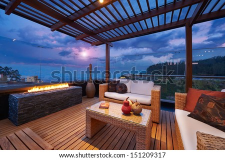 Interior design: Beautiful modern terrace lounge with pergola at sunset #151209317
