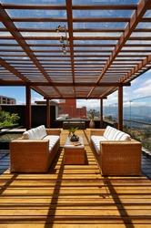 Interior design: Beautiful terrace lounge with pergola