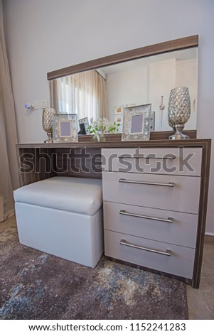 Interior design decor furnishing of luxury show home bedroom with dressing table vanity unit