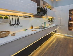 Interior design decor showing modern kitchen and appliances in luxury apartment showroom