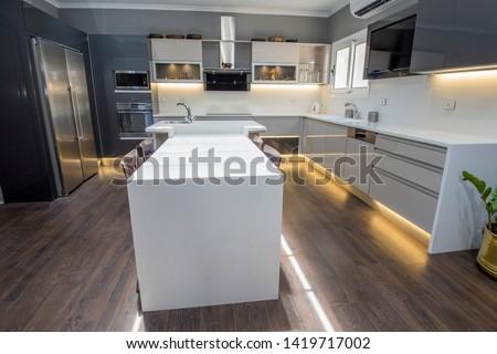 Interior design decor showing modern kitchen with cupboards in luxury apartment showroom ストックフォト ©