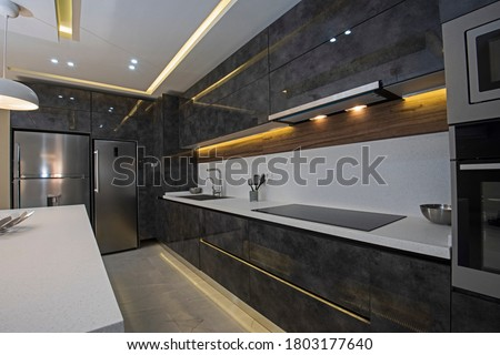 Interior design decor showing modern kitchen with cupboards in luxury apartment showroom Stock photo ©