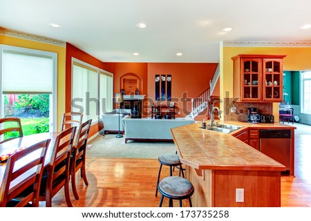 Interior Design For Kitchen, Dining And Living Room Combination. Yellow Walls Of Kitchen And Dining Room Match Well With Orange Color Of Living Room