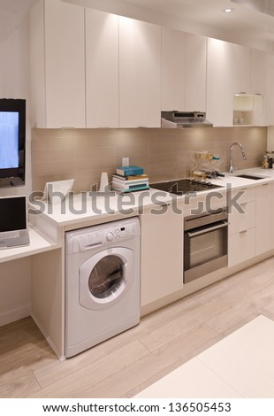 Interior design of a combination of a modern kitchen and a laundry