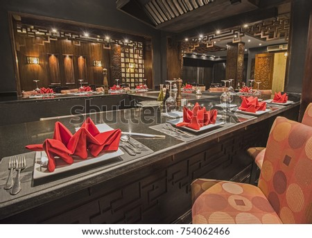 Interior design of a luxury hotel resort Asian restaurant dining area with ornate decor #754062466