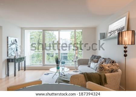 Interior design of a luxury living room with beautiful watercolors on the walls