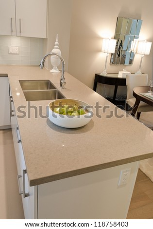Interior design of a luxury modern kitchen with the dish with some pears