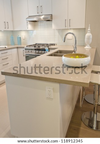 Interior design of a luxury modern kitchen with the dish with some pears on the counter. I