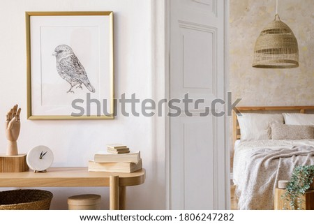 Interior design of bedroom with mock up picture frame, wooden console, plants, clock book, rattan decoration and elegant accessories in stylish home decor. Foto stock ©