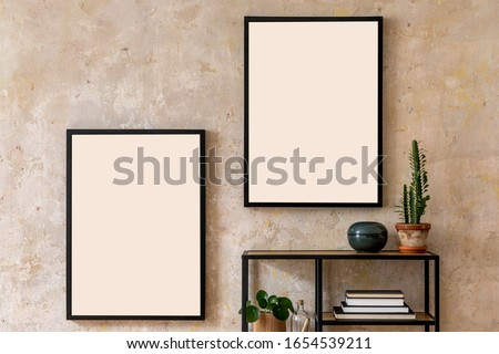 Interior design of living room with two black poster mock up frames, shelf, cacti, plant, books and elegant personal accessoreis. Grunge wall. Stylish home decor. Template.