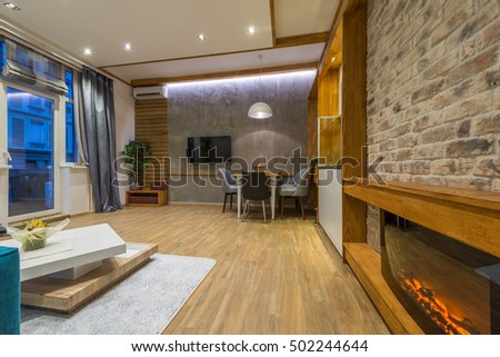 Interior design of modern dining room with sofa - Shutterstock ID 502244644