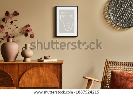 Interior design of unique living room with stylish commode, armchair, dired flowers in vase, mock up poster on the wall, decoration and personal accessories in modern home decor. Template. Photo stock ©