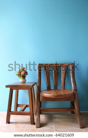 interior design of wood chair on a blue wall.